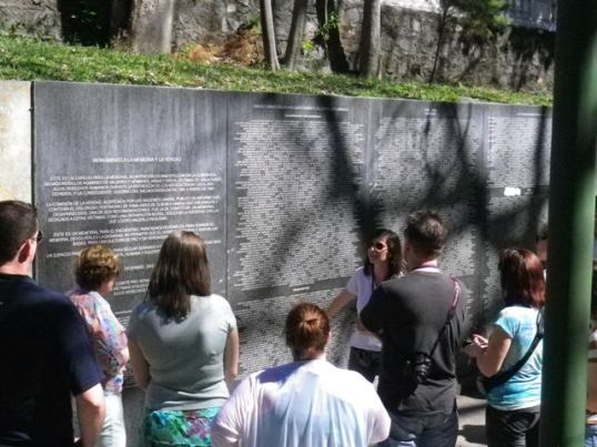 Cristosal's Olivia Almaden  speaks about the memorial monument.